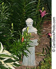 St Francis of Assisi wbirds nest - a beautiful garden statue...
