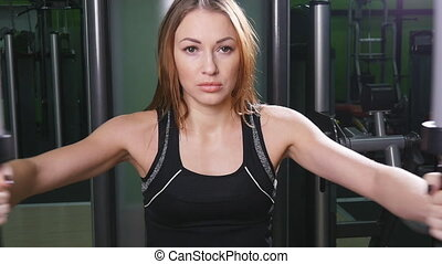 Woman training in gym - Portrait of young female training in...