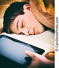Teenager sleep with Tablet - Toned Photo of Tired Teenager...