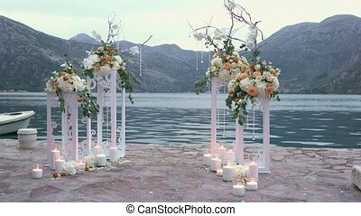 decorated place for a wedding ceremony near the sea