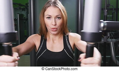 Woman exercising building muscles - beautiful muscular fit...