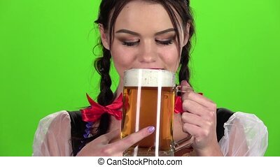Girl drinks beer and sexy licked. Green screen. Slow motion...
