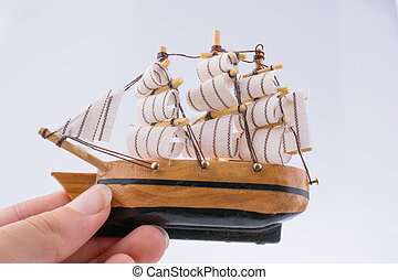 Little wooden model boat in hand - Little woodenl model boat...