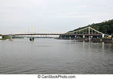 Bridge across the river Dnipro in Kyiv, Ukraine. Rivers and...