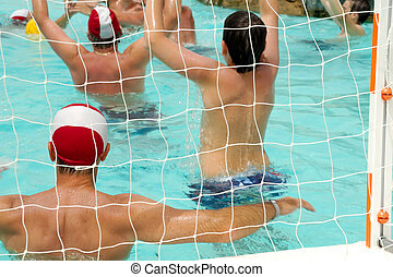 People are playing water polo - A group of people are...