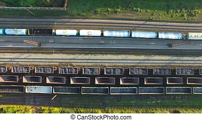 Railroad with wagons. Aerial survey - Flying over the...