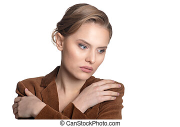 Sad young woman - Portrait of sad young woman in brown...