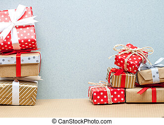 two piles of christmas gifts - two piles of different...