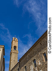 Montalcino, Italy - View at medieval bell tower in...