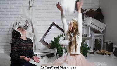 Cute boy and a beautiful girl tosses up snow - Cute boy and...
