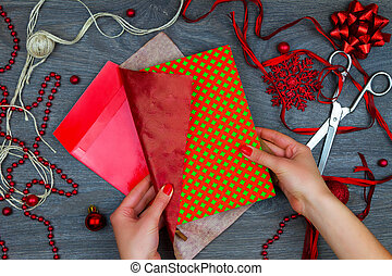 Wrapping up christmas gift. - Girl wrapping up colorful...