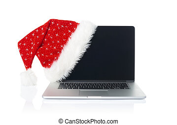 Online Christmas shopping. Opened laptop with Xmas Santa hat...