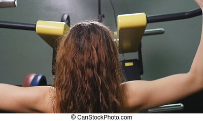 Woman at the gym working out on a machine