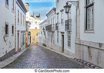 View of street in the old town Faro. - View of street in the...