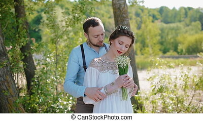 Young caucasian couple pose to photographer. Woman sniff the...