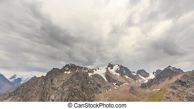 Clouds over snowy peaks. Time Lapse. Chimbulak. Almaty....