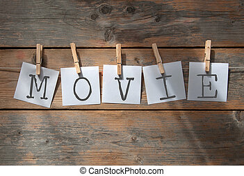 Movie review concept - Movie spelt using notes hanging on...