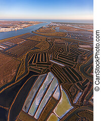 Aerial. Salt lakes and swamps filmed from the sky. Portugal...