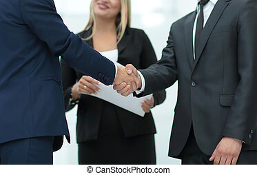 welcome and handshake of business partners before a mee -...