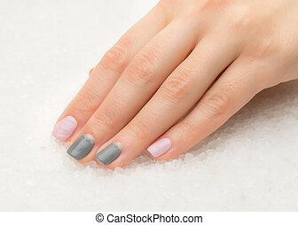 Beautiful woman's nails with nice stylish manicure