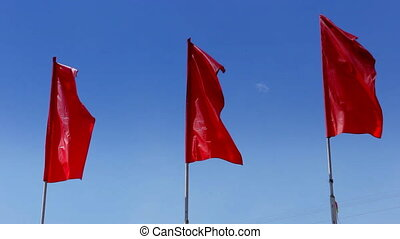 Red flags in the wind - Three red flag fluttering in the...
