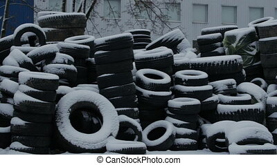 Stacks of tires covered with snow.4k
