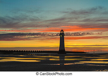 Gorgeous landscape Perch Rock Lighthouse, New Brighton, Merseyside at sunset