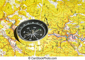 Symbols of travel - map with compass. Navigation tools for...