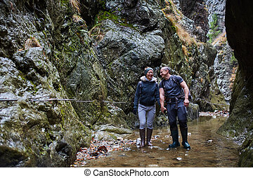 Couple of hikers in the canyon