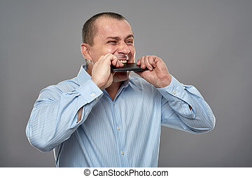 Angry businessman biting his cellphone - Angry business man...