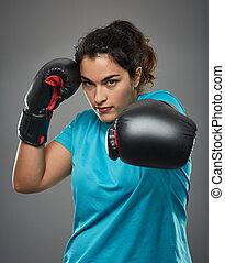 Latino female fighter delivering a jab - Hispanic female...