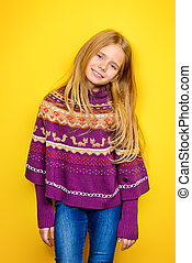 girl in poncho