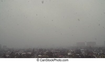 Large snow falls - Heavy snowfall in the gray city in the...