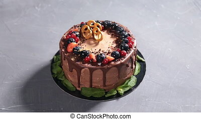 chocolate cake with fresh strawberry on rustic background