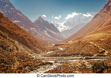 River in Nepal mountains, Manaslu mountain peak covered by...