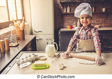 Little girl baking - Cute little girl in apron and chef hat...