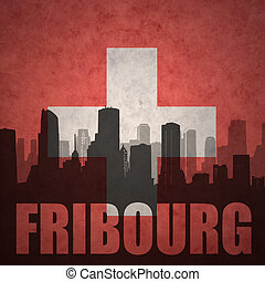 abstract silhouette of the city with text Fribourg at the...