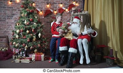Children taken away from Santa's bag with gifts - Little...