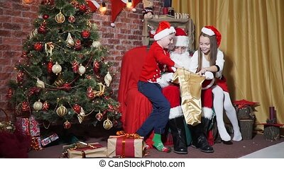 Children receive gifts from Santa
