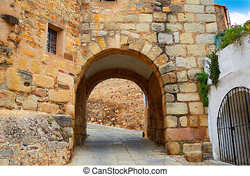 River door Arco del Cristo in Caceres of Spain at...