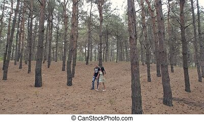 lovers walk in the woods