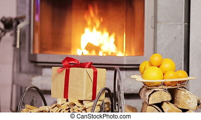 Beautiful fireplace decorated by gift and orange for...