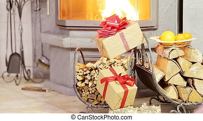 Beautiful fireplace decorated by gift and orange for Christmas