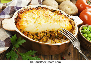 Cottage pie with meat and green peas