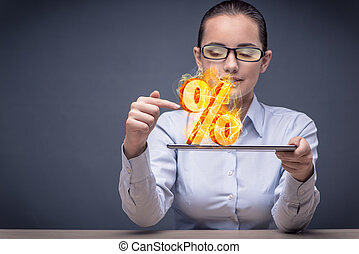 Businesswoman with percent sign in high interest concept