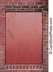 Red Metal Plate on Brick Wall - Close-up of red metal plate...