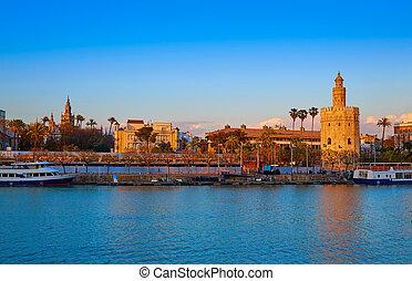 Seville sunset skyline torre del Oro and Giralda in Sevilla...
