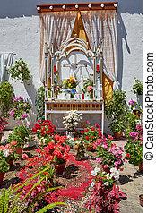 Monesterio religious flowers altar by via de la Plata way in...