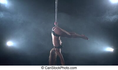 View of sexy dancer doing handstand near pylon - View of...