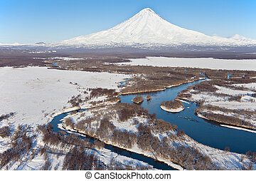 Volcano and river - Volcano in the winter against not...